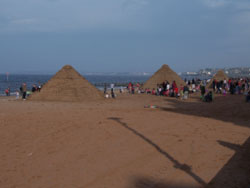 3 pyramids built out of sandbags on Portobello beach during the summer of 2007